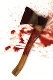 Bijl in de ketchup Stock Afbeelding