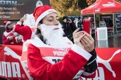 Bijna 10.000 Santas nemen aan Babbo deel Lopend in Milaan, Italië Royalty-vrije Stock Fotografie