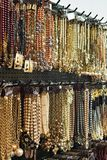 Bijou or fake similar to gold jewelry on market Stock Photo