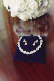Bijoux et bouquet de mariage Image libre de droits