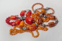 Bijoux rouges rustiques Photographie stock libre de droits