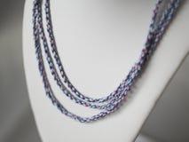 Bijoux tordus colorés de cordes Photographie stock libre de droits