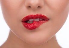 Bijtende lippen. Royalty-vrije Stock Afbeeldingen