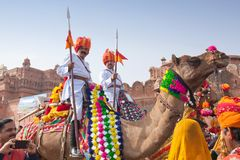 Bikaner Camel festival in Rajasthan, India. BIKANER, INDIA - JANUARY 12, 2019: Indian warriors riding on camel during festival in Rajasthan. The Camel Festival royalty free stock images