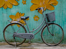 Bike 1. Old bike up against a grungy colourful wall Stock Image