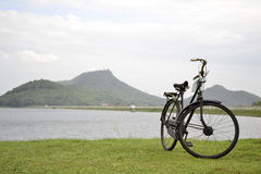 Bike. Parked along the reservoir at Thailand Stock Photos