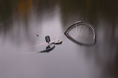 Bike. Broken bycicle floating in a lake in goteborg Sweden stock photos