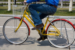 On a Bike. A man riding a bicycle to work Royalty Free Stock Photos