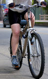 Bike. A woman on a bike Royalty Free Stock Photography