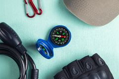 Bike accessories-compass, bicycle gloves, bicycle lock, carabiners and cap.  royalty free stock photo