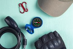Bike accessories-compass, bicycle gloves, bicycle lock, carabiners and cap.  stock photo