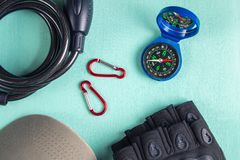Bike accessories-compass, bicycle gloves, bicycle lock, carabiners and cap.  royalty free stock photography