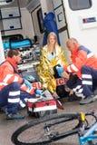 Bike accident woman emergency doctor bandage leg Royalty Free Stock Images