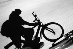 Bike action. Biking down a hill view from the cyclist at low shutter speed royalty free stock photo