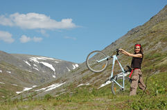 Bike adventure #2. Bike adventure! Girl biking in high mountains Stock Photography