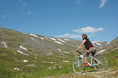 Bike adventure! #4. Girl biking in high mountains Stock Images