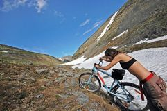 Bike adventure! #5. Girl traveling in the high mountains. Wide angle Stock Photography