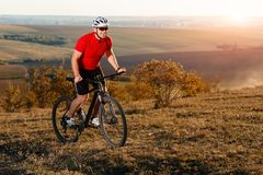 Bike adventure travel photo. Cyclist on the Beautiful Meadow Trail on sunny day. Stock Photos