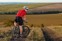 Bike adventure travel photo. Cyclist on the Beautiful Meadow Trail on sunny day. Stock Image