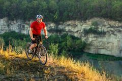 Bike adventure travel photo. Cyclist on the Beautiful Meadow Trail on sunny day. Bike adventure travel photo. Bike tourists ride on the country. Cyclist on the Royalty Free Stock Images