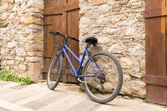 Bike against the traditional wall of Nafplio in Greece. Royalty Free Stock Image