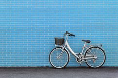 Bike against a Turquoise Brick Wall royalty free stock photos