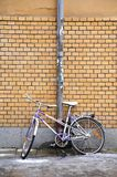 Bike against wall. Urban bike against yellow brick all Royalty Free Stock Images