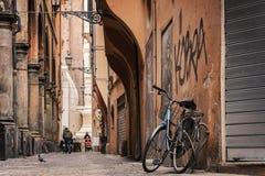 Bike against wall Stock Photo