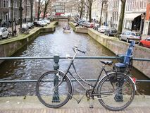 Bike at Amsterdam canals Royalty Free Stock Photo