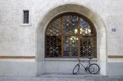 Bike and arched window. A bike rests against a window in an alley in Zurich, Switzerland stock photo