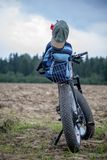 Bike with backpack in countryside stock photography