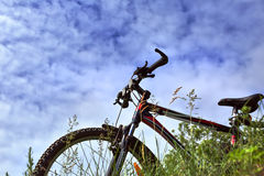 The bike on the background of sky and grass, view from bottom. Berdsk, Novosibirsk oblast, Siberia, Russia - June 12, 2017: the bike on the background of sky and Royalty Free Stock Photography