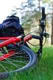 Bike and Backpack Close-up Lying on Green Grass Stock Image