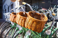 Bike basket close up. Bikes in row for rent. Vintage style bikes parked in row Royalty Free Stock Image