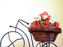 Bike with basket of flowers. Stock Photos