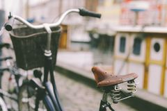 Old bicycle  in Copenhagen. A bike with  basket parked on a street in Copenhagen city Royalty Free Stock Photo