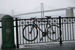 Bike and Bay Bride in the fog and rain- Ferry Buil Stock Image