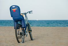 Bike at the beach. Bike with baby seat on the sand at the beach Royalty Free Stock Photography
