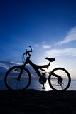 A Bike on the Beach. Silhouette of a Bike on the Beach Royalty Free Stock Photography