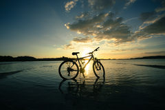 Bike on beach Stock Image