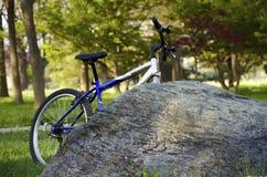 Bike behind rock Stock Image