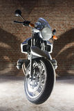 Bike from below. Motorbike against a brick. The bike is pictured from the front Stock Photography