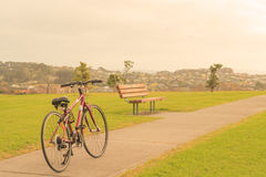 Bike, bench and the view from the hill, Whangaparaoa, around Auckland, New Zealand. Horizontal photo, photo took in New Zealand, photo is usable on picture Royalty Free Stock Photo
