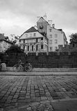 Bike on the block pavements on the background of medieval houses. In Warsaw Black and white Stock Photo