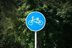 Bike on a blue round sign Stock Images