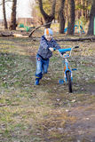 By bike. The boy is on a bicycle royalty free stock photos