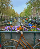 Bike on a bridge in Amsterdam stock image