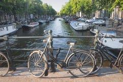 Bike on a bridge in Amsterdam, Netherlands Stock Photos