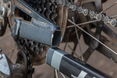 Bike broken frame. The broken frame of mountain bike. The back part of bike with the chain stay broken Stock Photos
