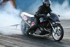 Bike Burnout. A motorcycle doing a burnout at Thompson raceway Ohio stock photos